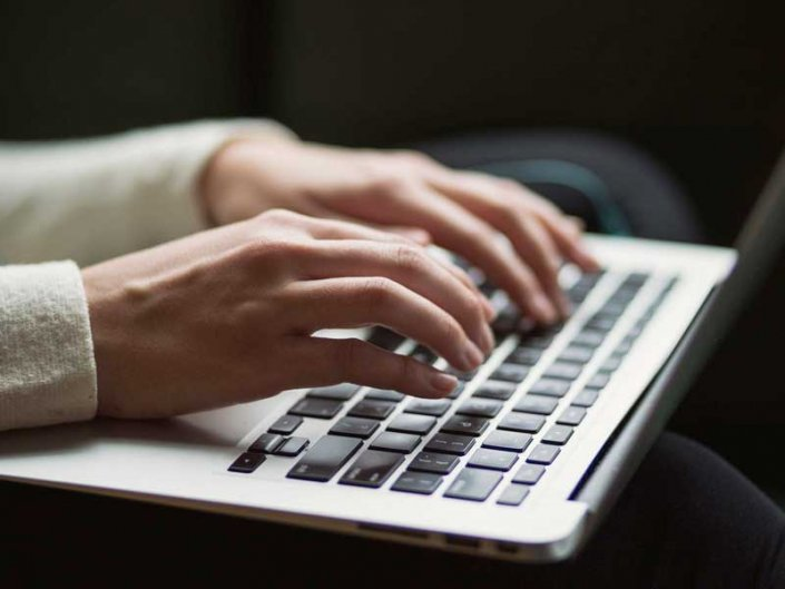 Person typing on keyboard
